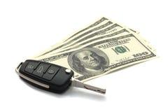 Chave e dólares do carro. Foto de Stock Royalty Free