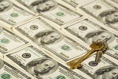 Chave e dinheiro Foto de Stock