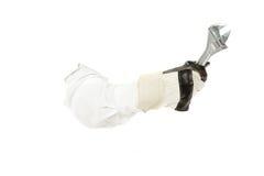 Chave inglesa com as luvas protetoras da mão, mão do canalizador. Imagem de Stock Royalty Free