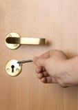 Chave, mão, porta Imagens de Stock