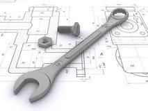 Chave, parafuso e porca de encontro aos desenhos de engenharia Imagem de Stock Royalty Free