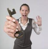Chave poderosa da terra arrendada da mulher de negócios do sucesso Foto de Stock Royalty Free