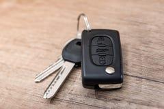 chave preta do carro na mesa de madeira Fotografia de Stock Royalty Free