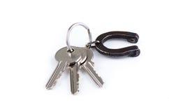 Chaves da casa com a ferradura no keyring Foto de Stock Royalty Free