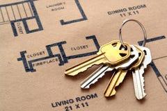 Chaves da casa em plantas de assoalho Foto de Stock Royalty Free
