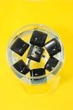 Chaves de computador no copo Fotografia de Stock