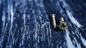 Chaves de fenda para reparar o encontro na tabela Trabalhos domésticos do ` s dos homens reparo Fotos de Stock