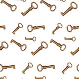 Chaves douradas sem emenda em um fundo branco Imagem de Stock