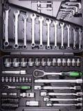 Chaves e chaves de fenda na caixa de ferramentas Imagem de Stock