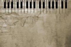 Chaves e notas Textured do piano fotos de stock