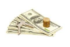 Chaves e pilha de dólares Imagem de Stock