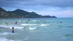 Koh Samui,Thailand, April 27, 2018. Chaweng beach. Unidentified people swimming in the sea. slow motion. 3840x2160. Chaweng beach. Unidentified people swimming stock footage
