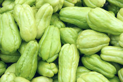 Chayote. The background of fresh chayote. Scientific name: Sechium edule Swartz Stock Images