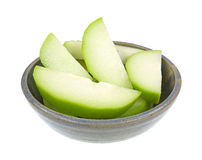 Chayote squash slices in old bowl Royalty Free Stock Images