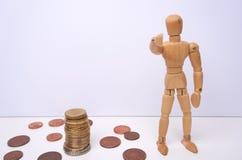 CHCEMY WAS - Drewniany mannequin, kukła, punkty jego palec przy wami z copyspace robienie pieniędzy , Biały tło obrazy royalty free