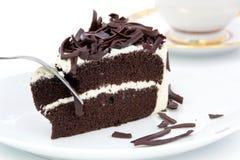 Chcolate kaka på den vita plattan Royaltyfri Bild