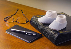 Chdeckbook & baby shoes Stock Image