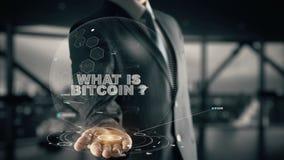 Che cosa è Bitcoin con il concetto dell'uomo d'affari dell'ologramma Fotografia Stock