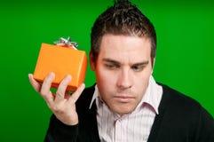 Che cosa è nel contenitore di regalo? Fotografia Stock Libera da Diritti