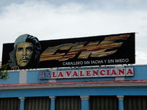 Che Guevara Billboard. Billboard of socialist revolutionary Che Guevara above a store in Cuba Royalty Free Stock Photo