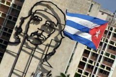 Che Guevara and Caban Flag. Cast iron Che Guevara monument on the side of ministry of interior, Plaza de la Revolucion, Havana Royalty Free Stock Photos