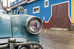 Che Guevara and Cuban classic car. A Che Guevara sticker placed on a headlight of a classic cuban car on a rainy day in Trinidad, Cuba stock photos