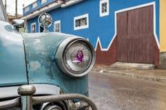 Che Guevara and Cuban classic car. A Che Guevara sticker placed on a headlight of a classic cuban car on a rainy day in Trinidad, Cuba Stock Photos