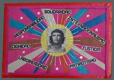 Che Guevara and slogans in a Havana primary school, Havana, Cuba. Handmade poster of Che Guevara and slogans in a Havana primary school, Havana, Cuba stock images
