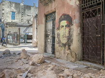 Che Guevara Street Art in Old Havana. Old Havana - April 2014. A painted portrait of Ernesto Che Guevara found among the rubble on a side street in Old Havana Royalty Free Stock Photography