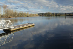 Cheadle Lake Reflection. Trees and a dock are reflected in Cheadle Lake mill pond in Lebanon, Oregon Stock Photography