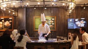 Cheaf Frying Food in Asian Restaurant with Open Kitchen in front of Customers. 4K. Bangkok, Thailand - 23 DEC 2017.