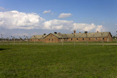 Cheap accommodation for Auschwitz prisoners behind a barbed wire fence Stock Photo
