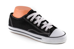 Cheap black and white sport shoes Stock Photos