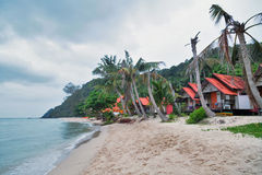 Cheap bungalows on a tropical beach Stock Image