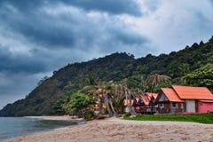 Cheap bungalows on a tropical beach Royalty Free Stock Photos