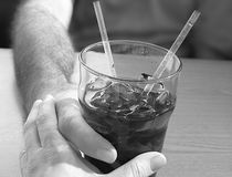 Cheap Date. Couple holding hands and sharing a softdrink royalty free stock photos