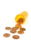 Cheap drug. A medication bottle with pennies coming out of it on a white background Royalty Free Stock Image