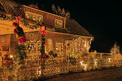 Cheap energy. A house lit to the max at X-mas Royalty Free Stock Photo