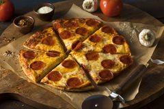 Cheap Greasy Frozen Pepperoni Pizza. Ready to Eat stock image