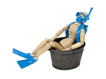 Cheap Home Vacation. Shown by a model wearing scuba diving equipment sitting in a metal tub - path included royalty free stock photos