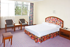Cheap Hotel Bedroom. Cheap but Elegant decorated bedroom with simple furnitures stock photo