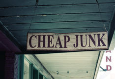 Cheap Junk. Hanging antique or used store sign stock photo