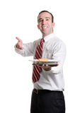 Cheap Lunch. A server is delivering a single battered wiener on a plate, isolated against a white background Stock Image