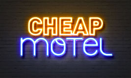 Cheap motel neon sign on brick wall background. Royalty Free Stock Photography
