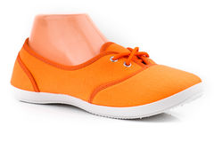 Cheap orange sport shoes Royalty Free Stock Photography