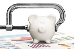 Cheap. Piggy Bank Recession Vise Grip Coin Bank Clamp Physical Pressure royalty free stock photography