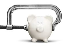 Cheap. Piggy Bank Recession Vise Grip Coin Bank Clamp Physical Pressure stock photography