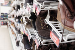 Cheap shoes in a supermarket, labels contain no protected info Royalty Free Stock Photos