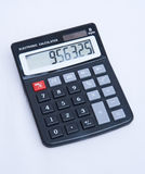 Cheap solar powered electronic calculator. stock photos