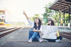 Free Cheap Travel And Lifestyle Concept.Holiday Time,Young Traveler Women Wearing Sneaker And Sitting At Train Station.Asian Backpacker Royalty Free Stock Image - 157745796